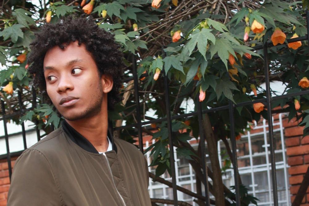 orange flowers pic bomber afro boy