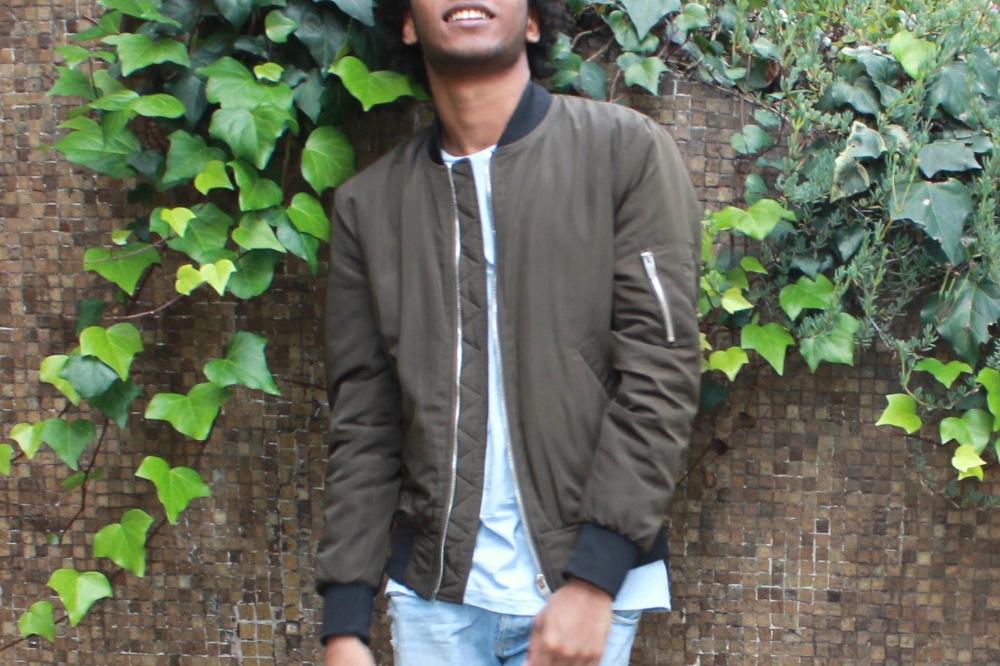 smile bomber jacket green wall blogger